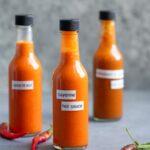 three bottles of homemade hot sauce