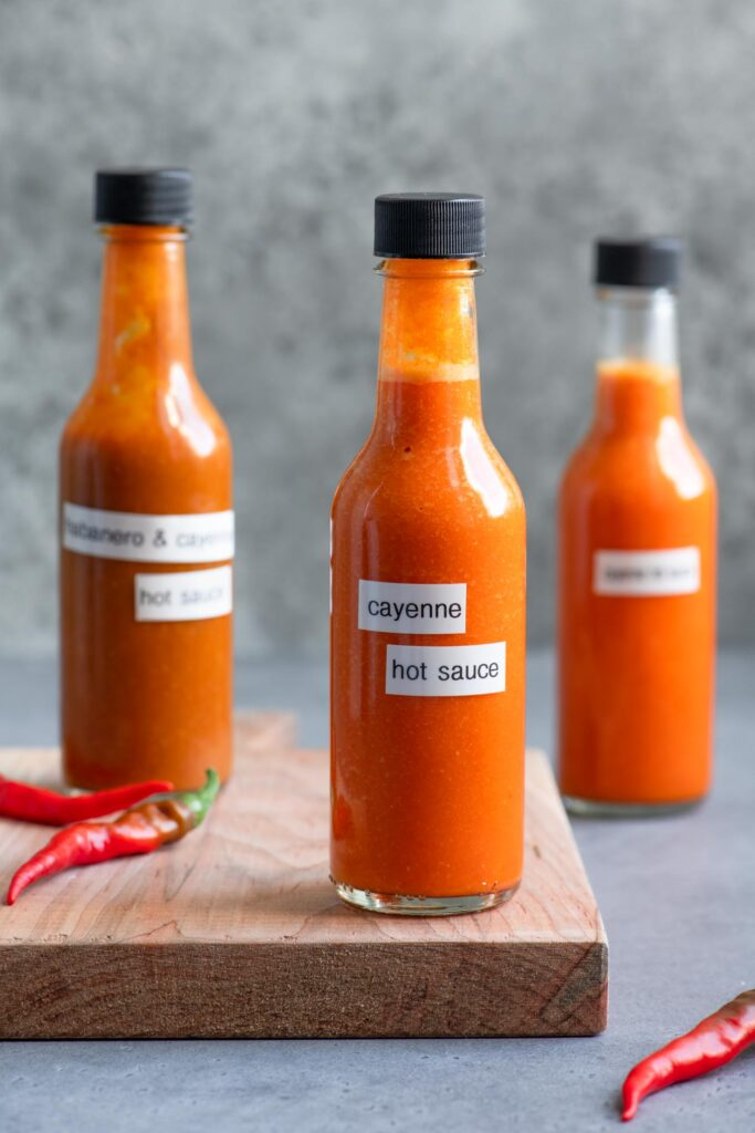 bottled homemade hot sauce with cayenne peppers