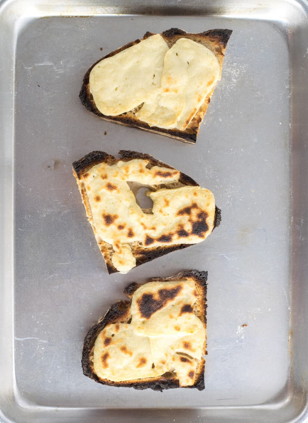 cheese broiled on bread to melt