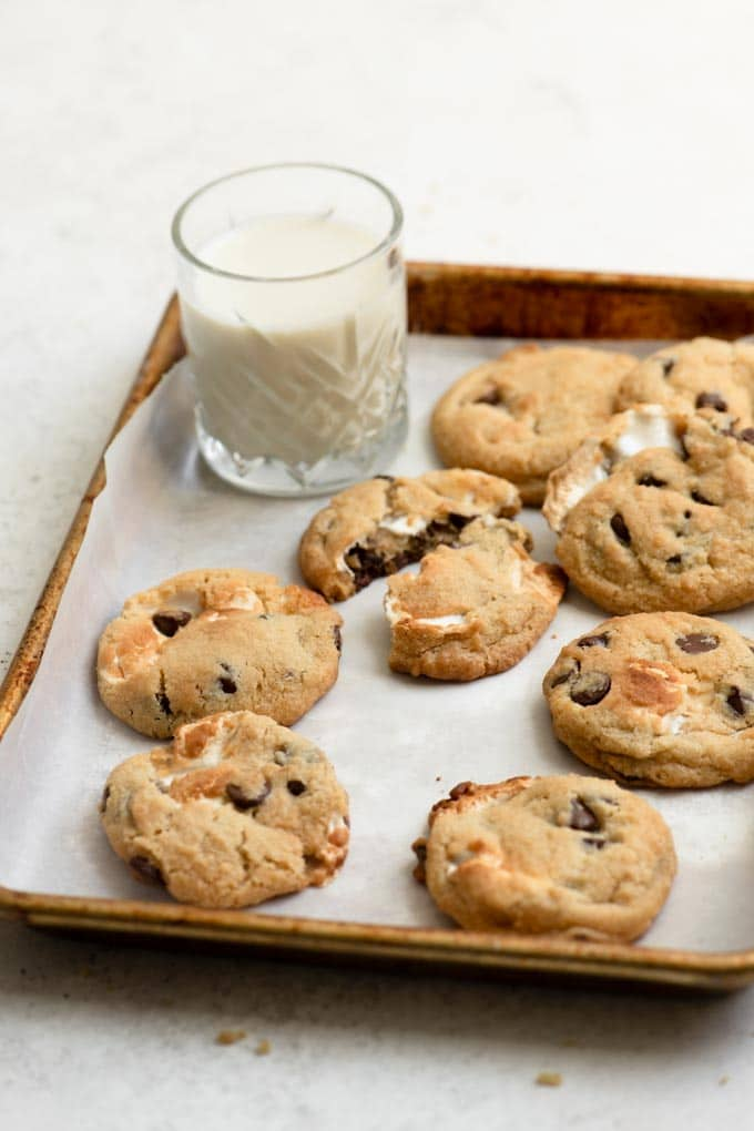 vegan chocolate chip marshmallow cookies with a glass of milk