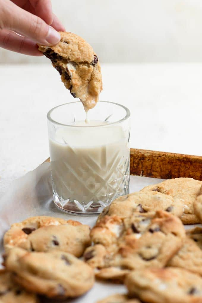 dipping a cookie into a glass of milk