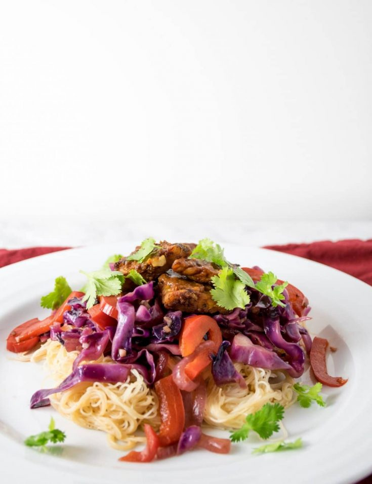 tamarind glazed tempeh with stir fried vegetables and rice noodles