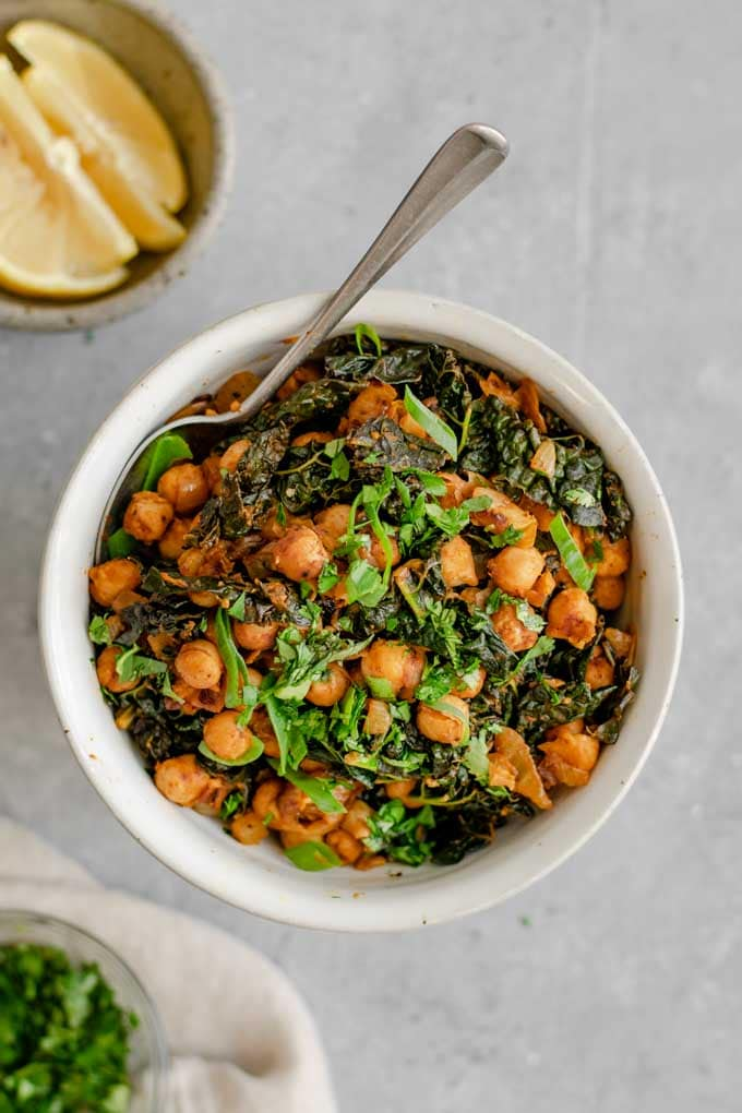 Indian chickpeas and greens served with extra lemon wedges