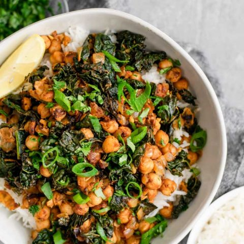 Indian spiced chickpeas and greens, garnished with cilantro and scallions