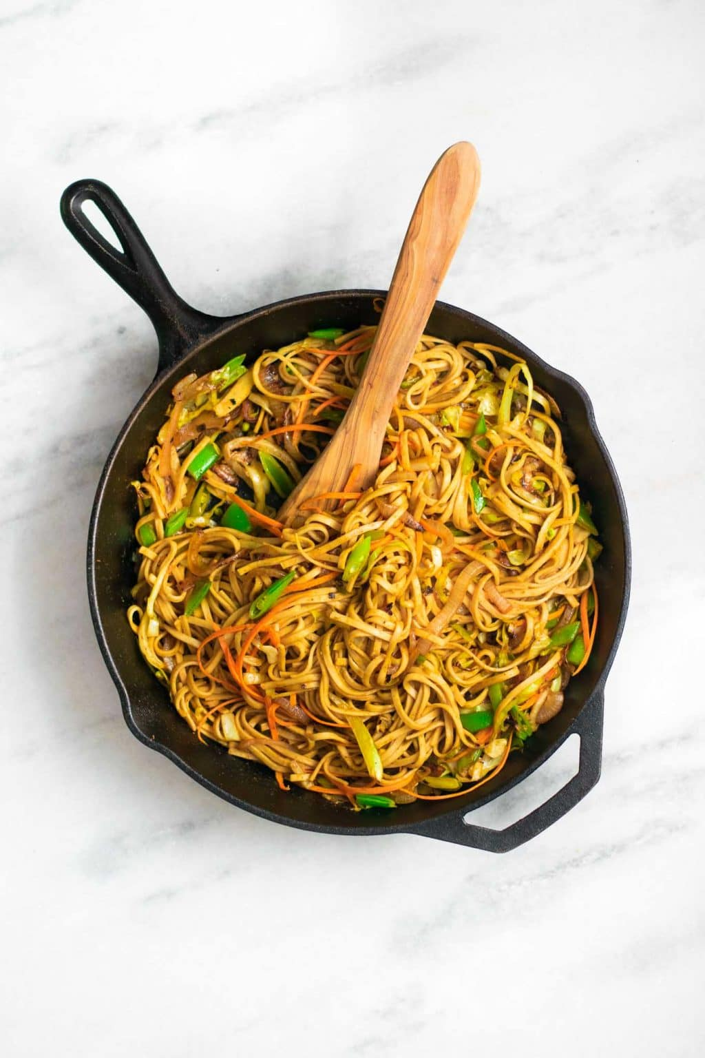 vegan singapore noodles made not traditionally with udon noodles in a cast iron skillet