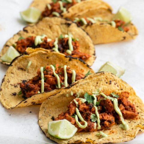 vegan tinga tacos with avocado crema