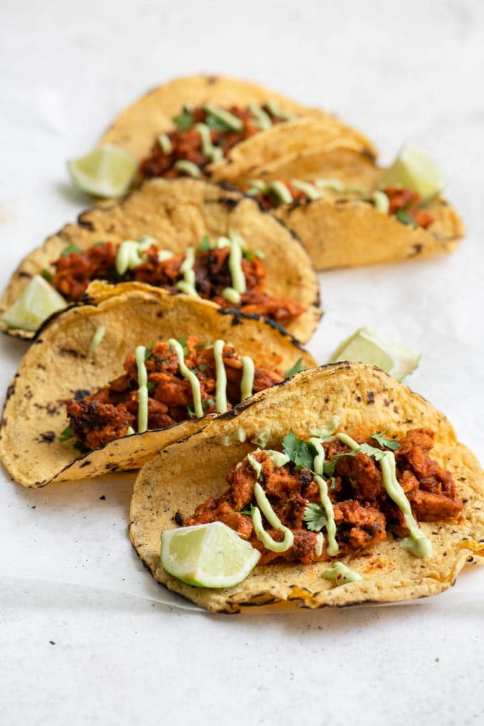 vegan tinga tacos with avocado crema