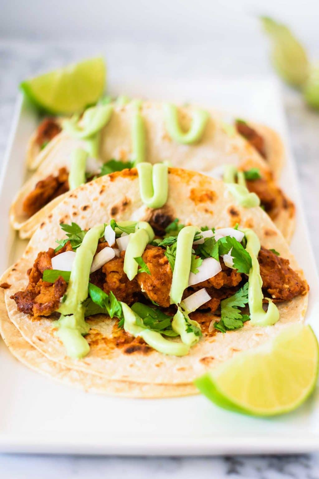 tinga tacos with avocado crema
