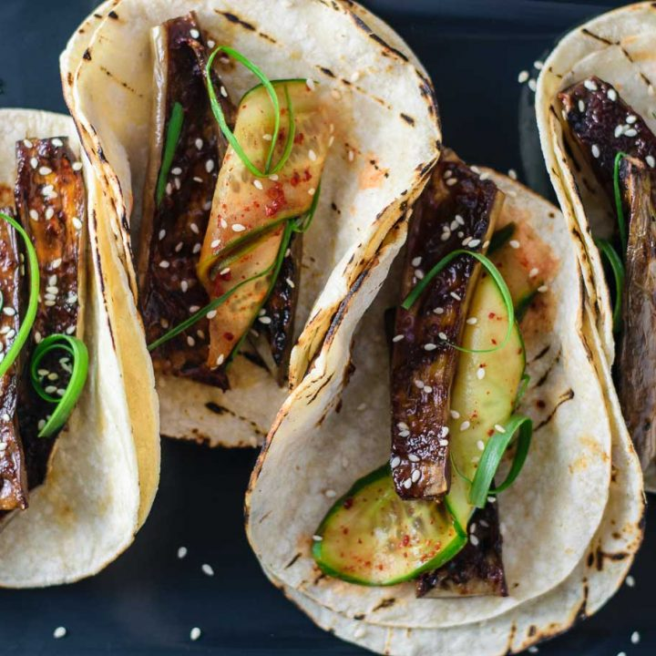prepared miso-glazed eggplant tacos with marinated cucumbers and scallions