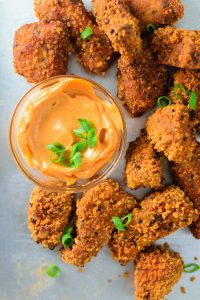 close of of gochujang tempeh wings with gochujang mayo dip