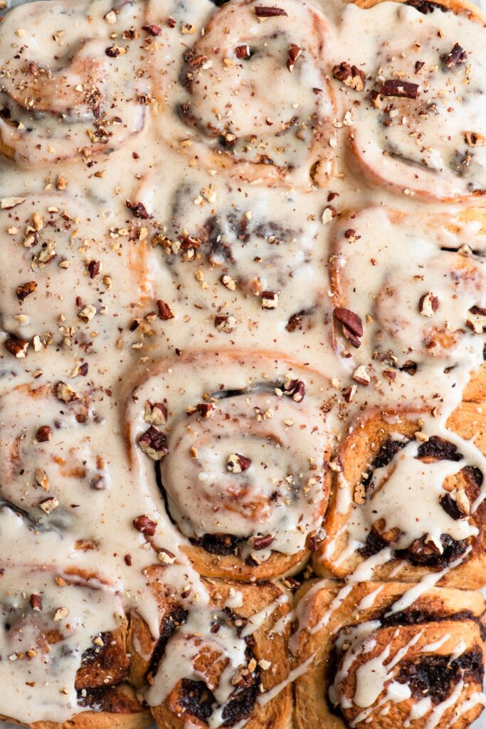 overhead closeup of frosted cinnamon rolls