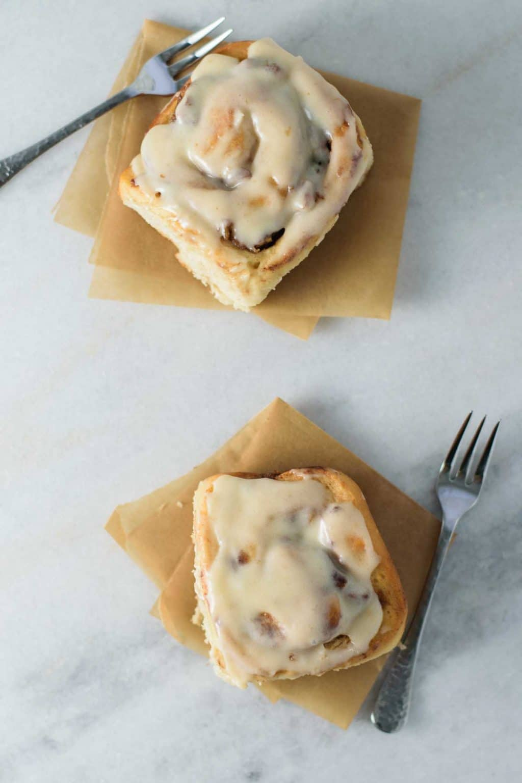 two apple pecan cinnamon buns served