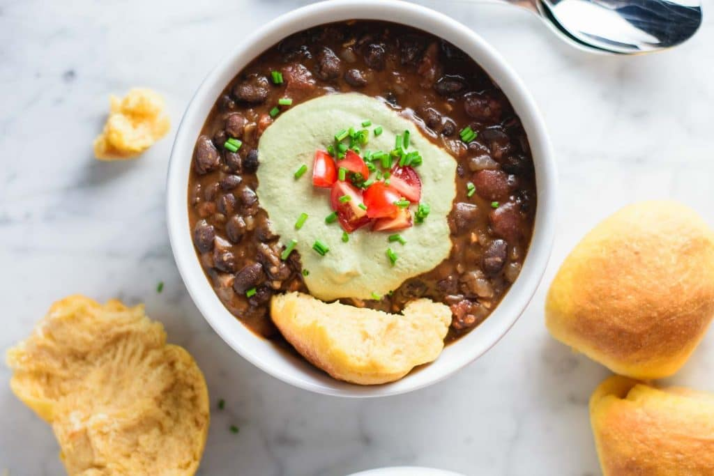 black bean soup with pepita cream and sweet potato rolls
