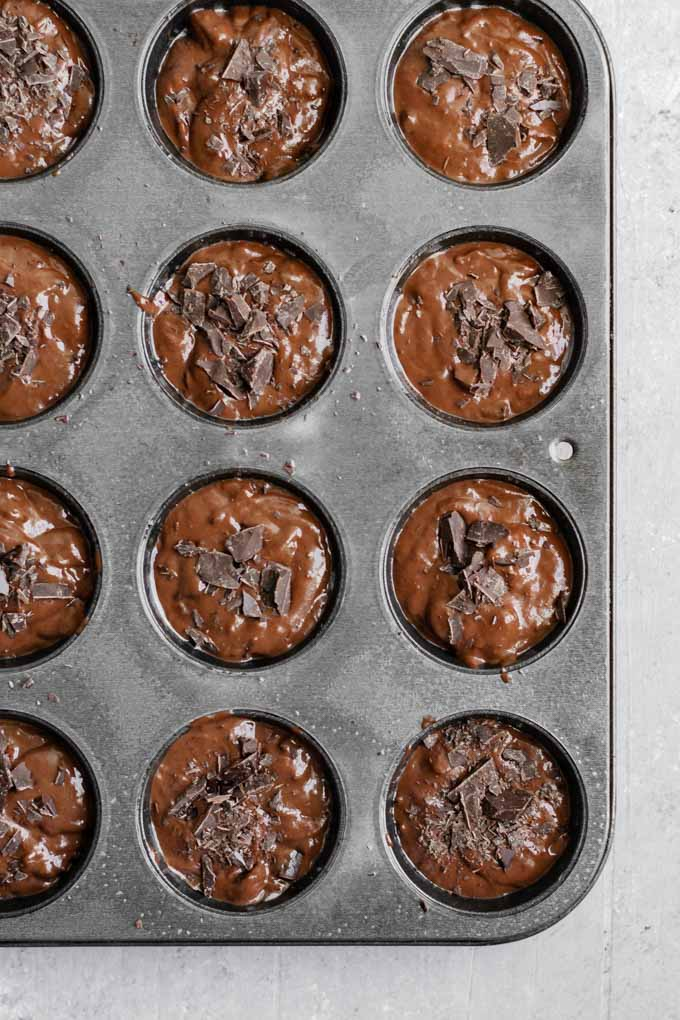 double chocolate banana muffins in muffin tin before baking