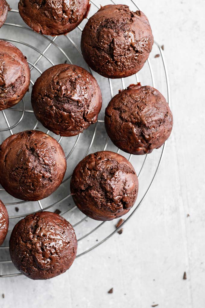 Vegan double chocolate banana muffins on cooling rack