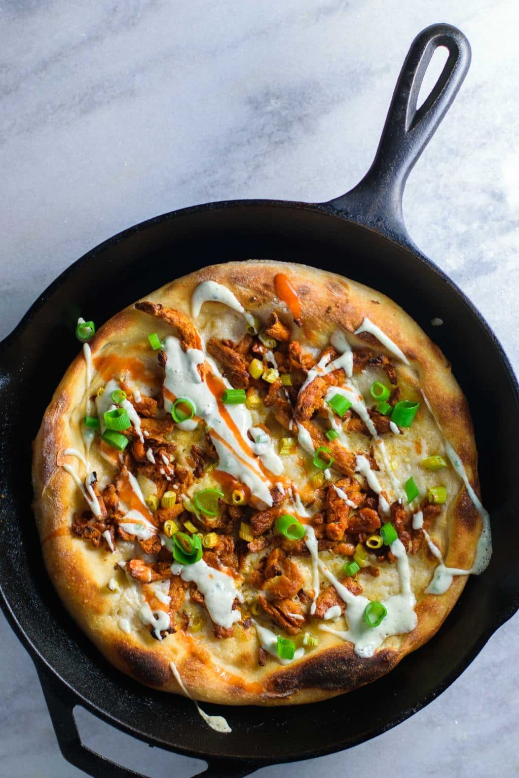 buffalo soy curl pizza with ranch dressing drizzle
