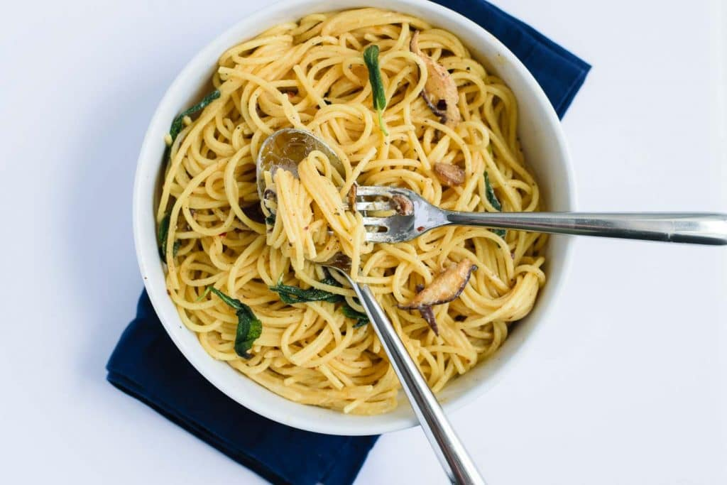 vegan spaghetti ai funghi with crispy sage (spaghetti and mushrooms in vegan cream sauce)
