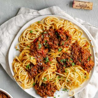 vegan black lentil bolognese with spaghetti and red wine