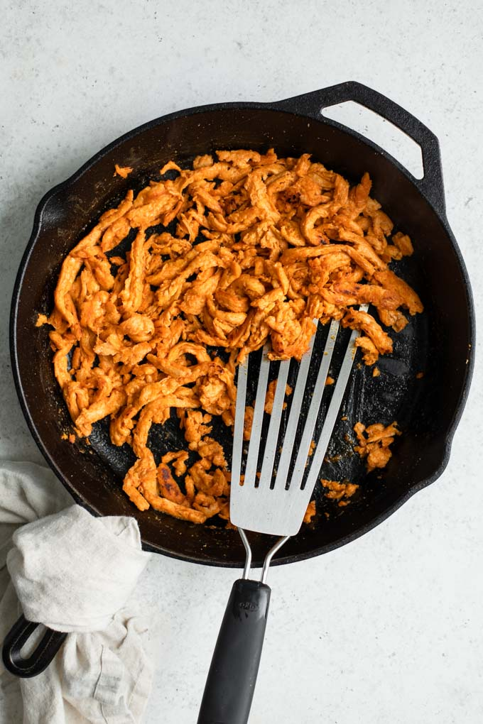 buffalo soy curls in cast iron skillet
