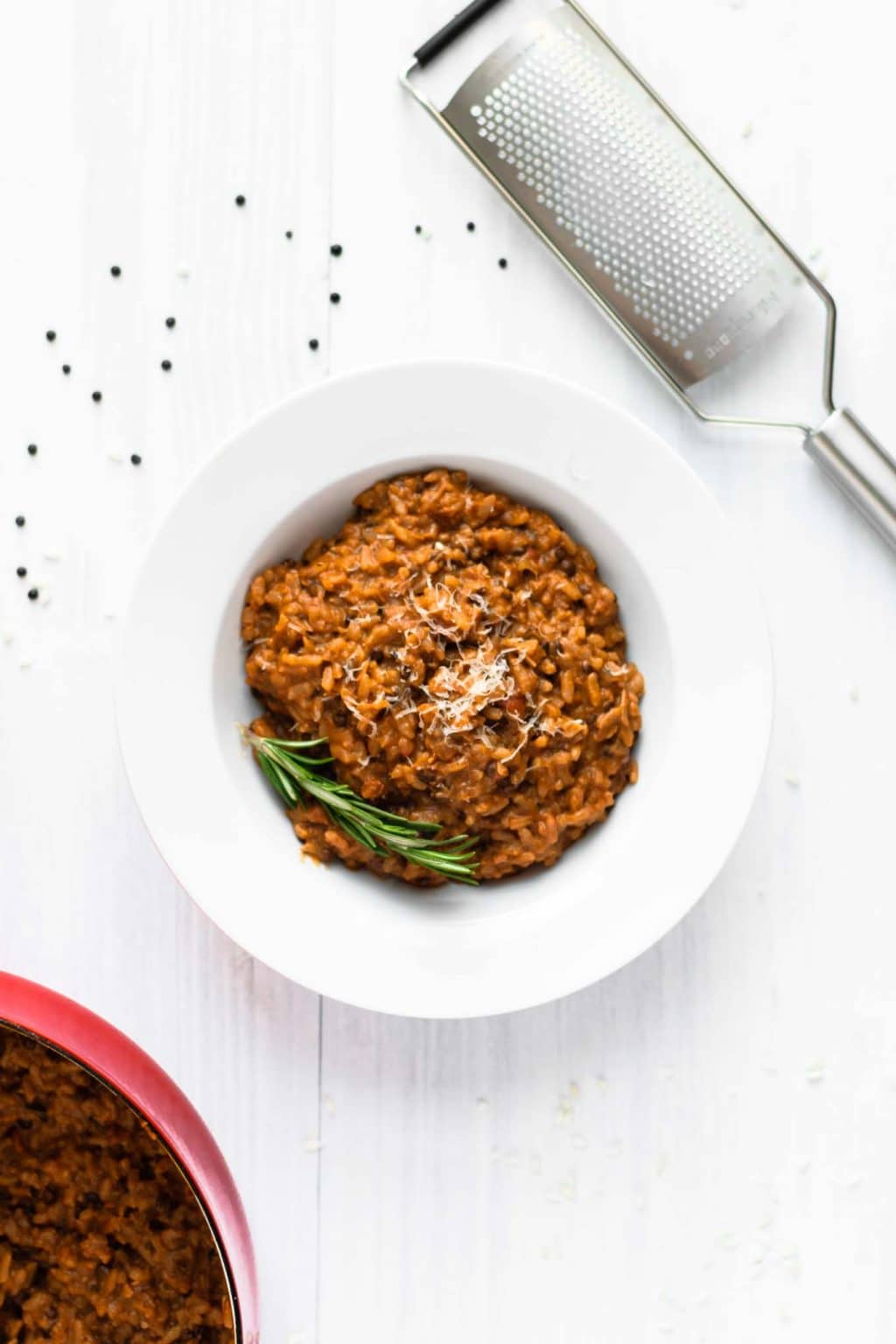 vegan risotto bolognese served with vegan parmesan