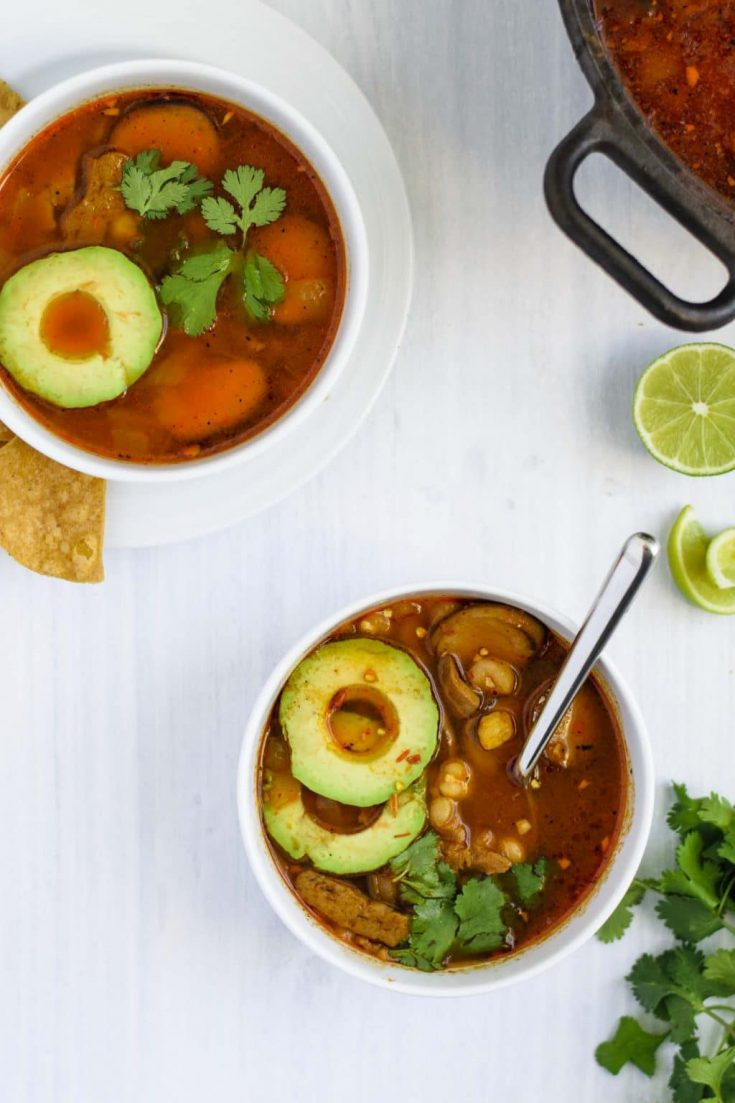 Seared Seitan and Mushroom Pozole Rojo | Pozole is a delicious brothy, Mexican soup with a red chili base. This ultra flavorful vegan version is full of hominy, seared seitan, and fried mushrooms. | thecuriouschickpea.com #vegan #pozole