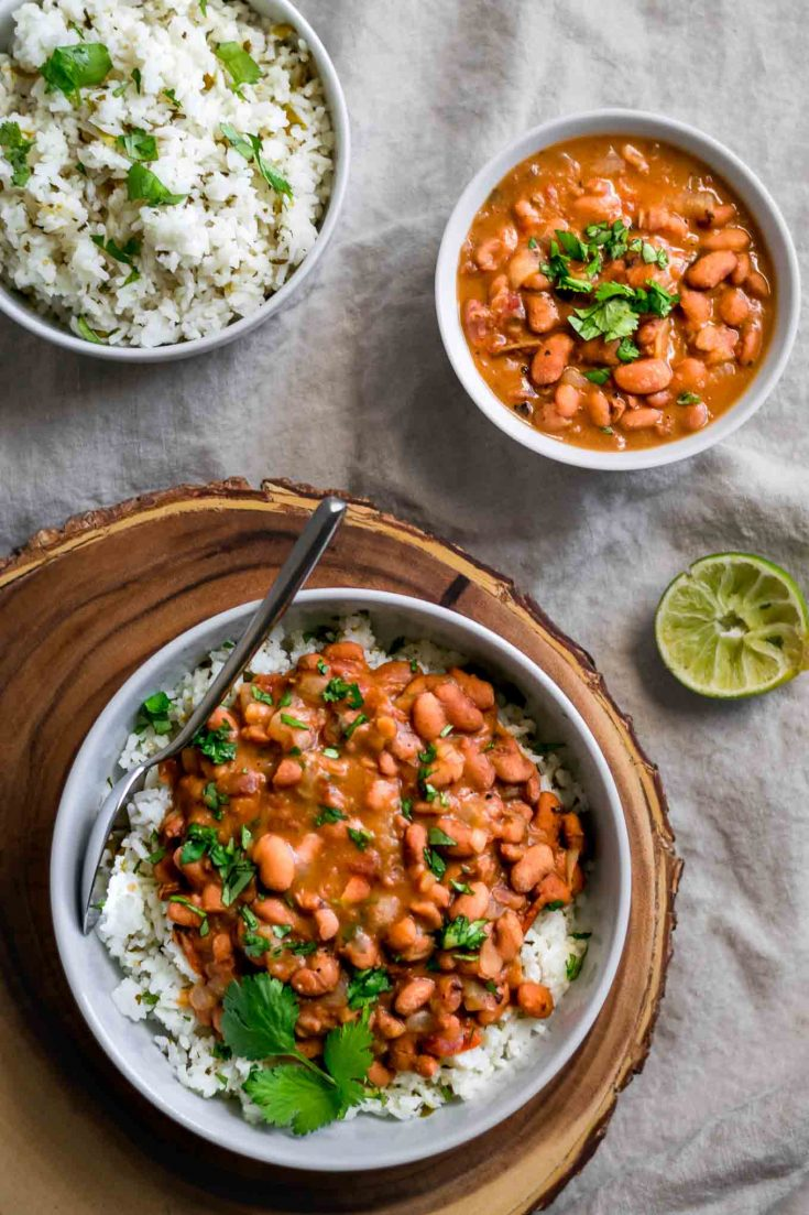 Mexican Pinto Beans & Tomatillo Cilantro Lime Rice | Pinto beans are cooked in the oven until tender and soft, then finished on the stovetop for flavorful, restaurant style, creamy beans. The rice is flavored with tomatillos, cilantro, and lime for the perfect tangy accompaniment | thecuriouschickpea.com #vegan #riceandbeans #veganmexican #pintobeans #tomatillo