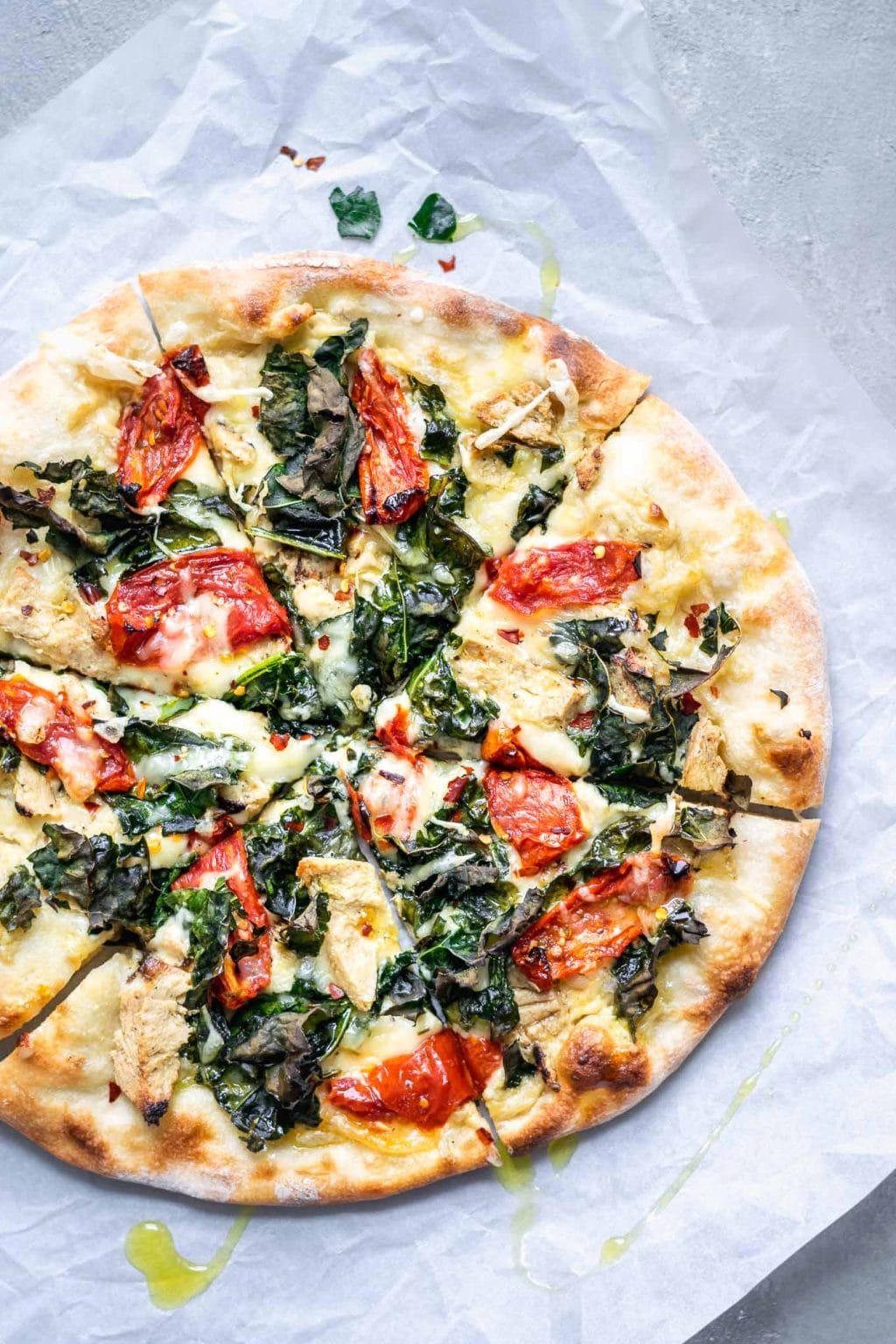 Crispy Kale, Roasted Tomato, and Vegan Chicken White Sauce Pizza