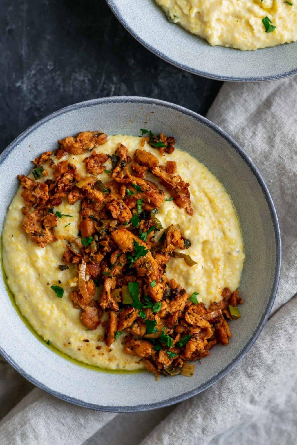 Cajun soy curls and creamy vegan jalapeño grits close up overhead of one bowl