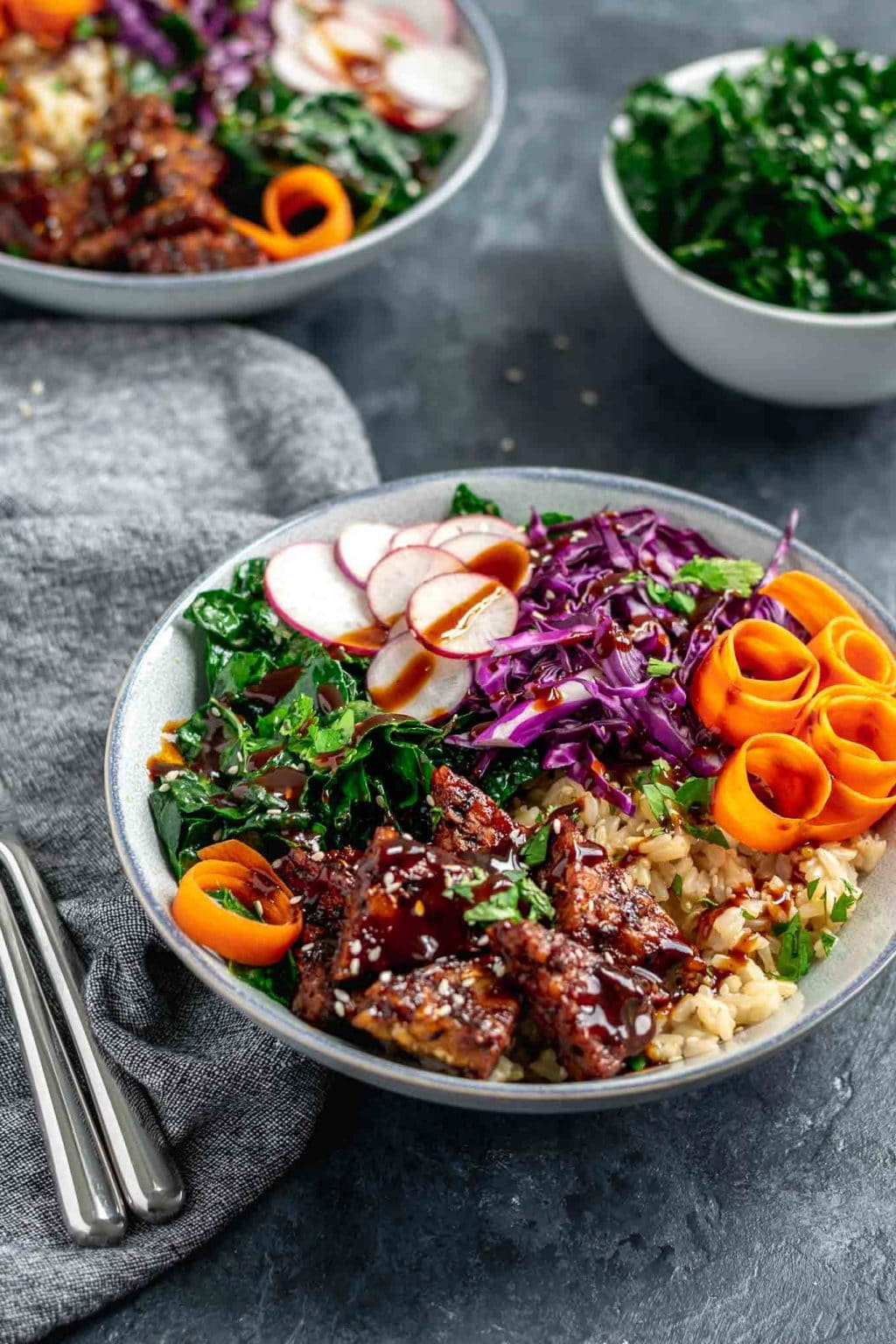 hoisin glazed tempeh bowls with sesame kale and hoisin sauce drizzle