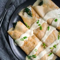 Savory Crepes with Almond Cheese, Sautéed Spinach and Vegan Hollandaise