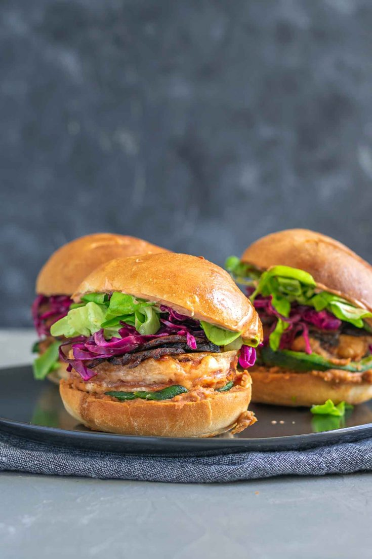 Tortas are a Mexican sandwich and this delicious version is filled with refried beans, vegan mayo, shredded lettuce, seitan bacon, roasted poblanos, cabbage slaw, and battered tofu steaks. It makes for a filling and protein-packed vegan sandwich. | thecuriouschickpea.com #vegan #torta #veganmexican #vegansandwich #tofu