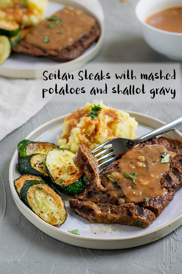 Homemade seitan steaks, grilled and served with mashed potatoes, sautéed zucchini and shallot gravy. If you're looking for a knife and fork sort of a meal, then this is your recipe! Juicy, chewy seitan steaks are doused in a flavorful shallot gravy with a side of mashed potatoes and sautéed veggies. A veganized 'meat and potatoes,' if you will. | thecuriouschickpea.com #vegan #seitan #gravy #vegansteak