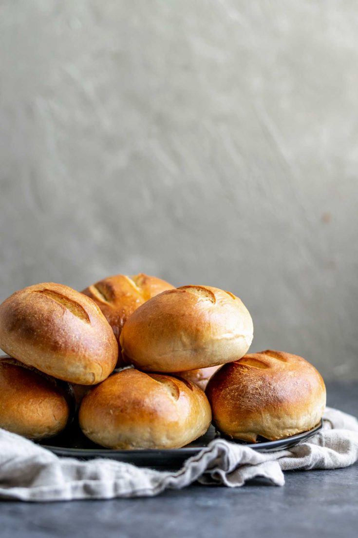 A soft and slightly crusty bread perfect for stuffing with your favorite sandwich fillings. A lightly enriched dough, these ultimate homemade sandwich rolls make great tortas, banh mi, subs, and more! | thecuriouschickpea.com #vegan #baking #rolls #bread