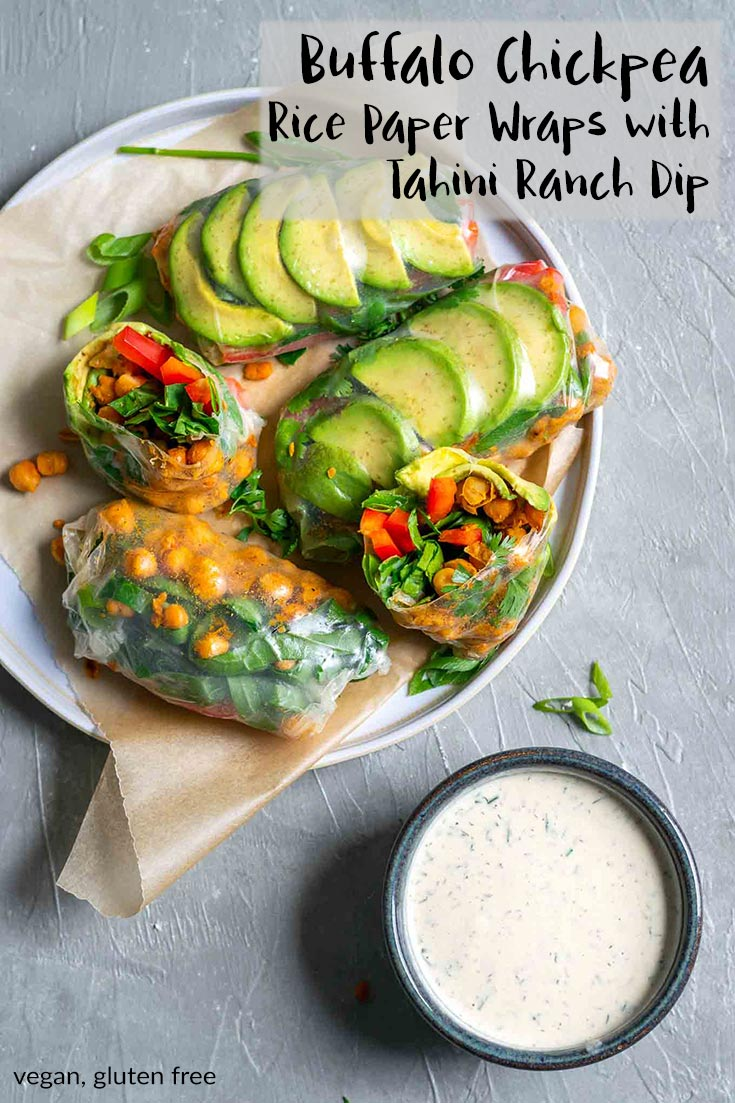 These salad wraps are stuffed with spicy pan roasted buffalo chickpeas, avocado, shredded collard greens, red bell pepper, and fresh herbs. They're rolled up in rice paper then dipped in a tahini ranch dressing, they're the perfect light meal or snack on the go. They're fresh tasting and perfect for summer. | thecuriouschickpea.com #vegan #healthy #glutenfree