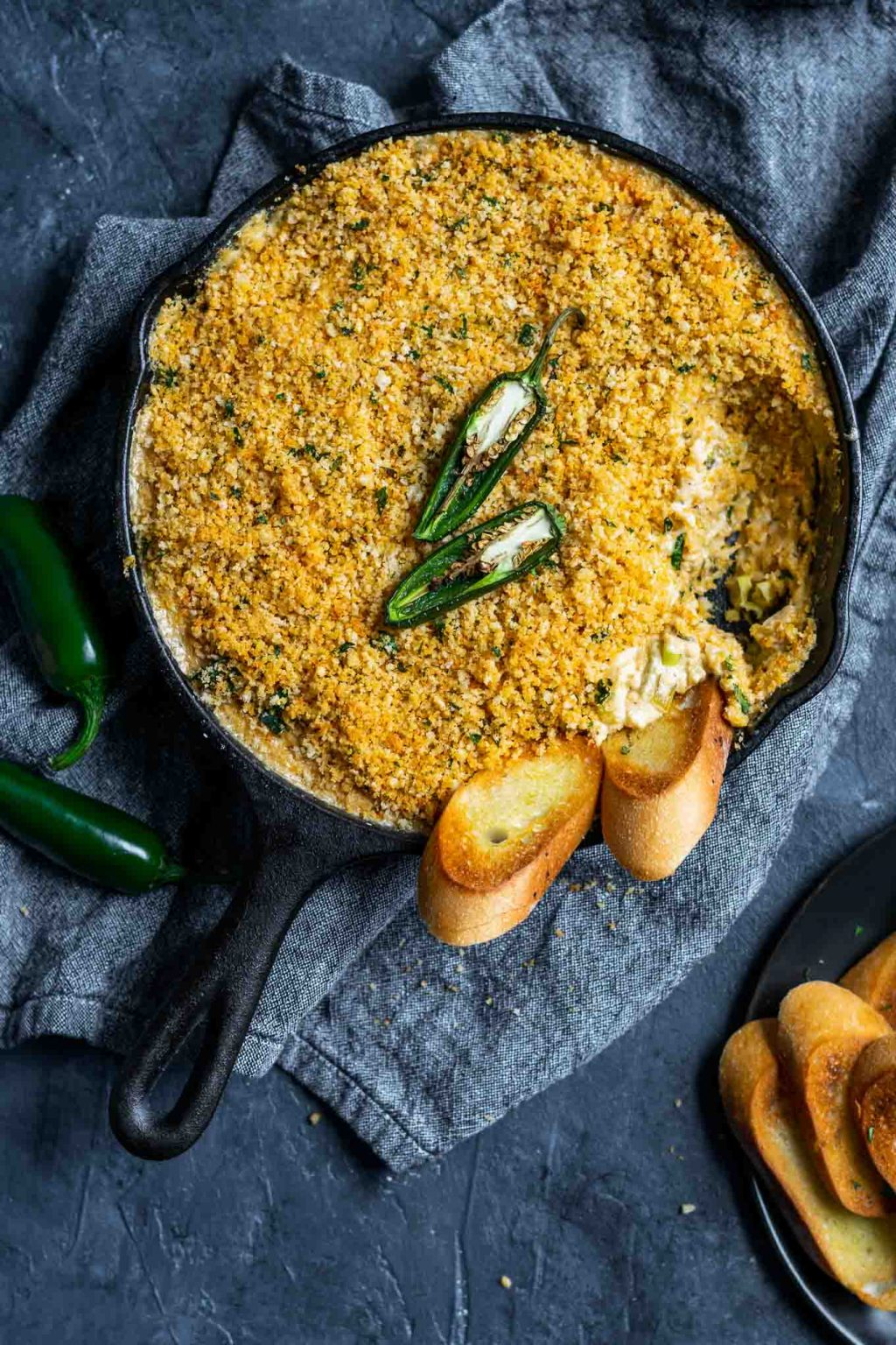 vegan jalapeño popper dip baked in a cast iron skillet