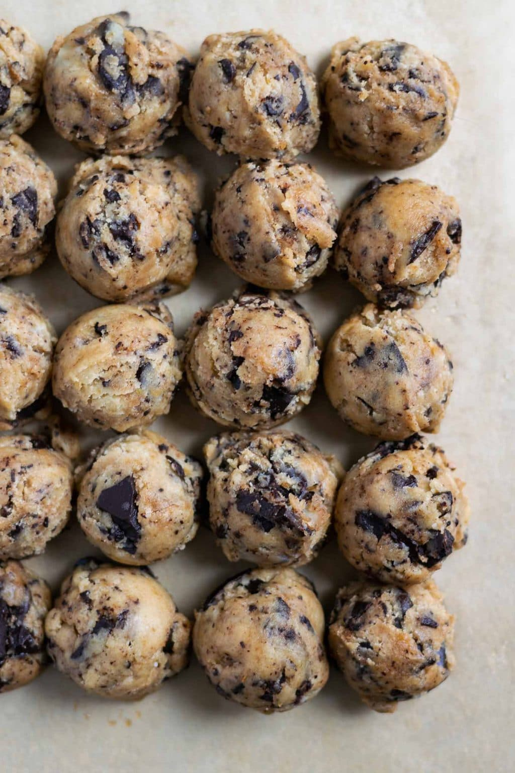 cookie dough balls of chewy vegan tahini chocolate chip cookies