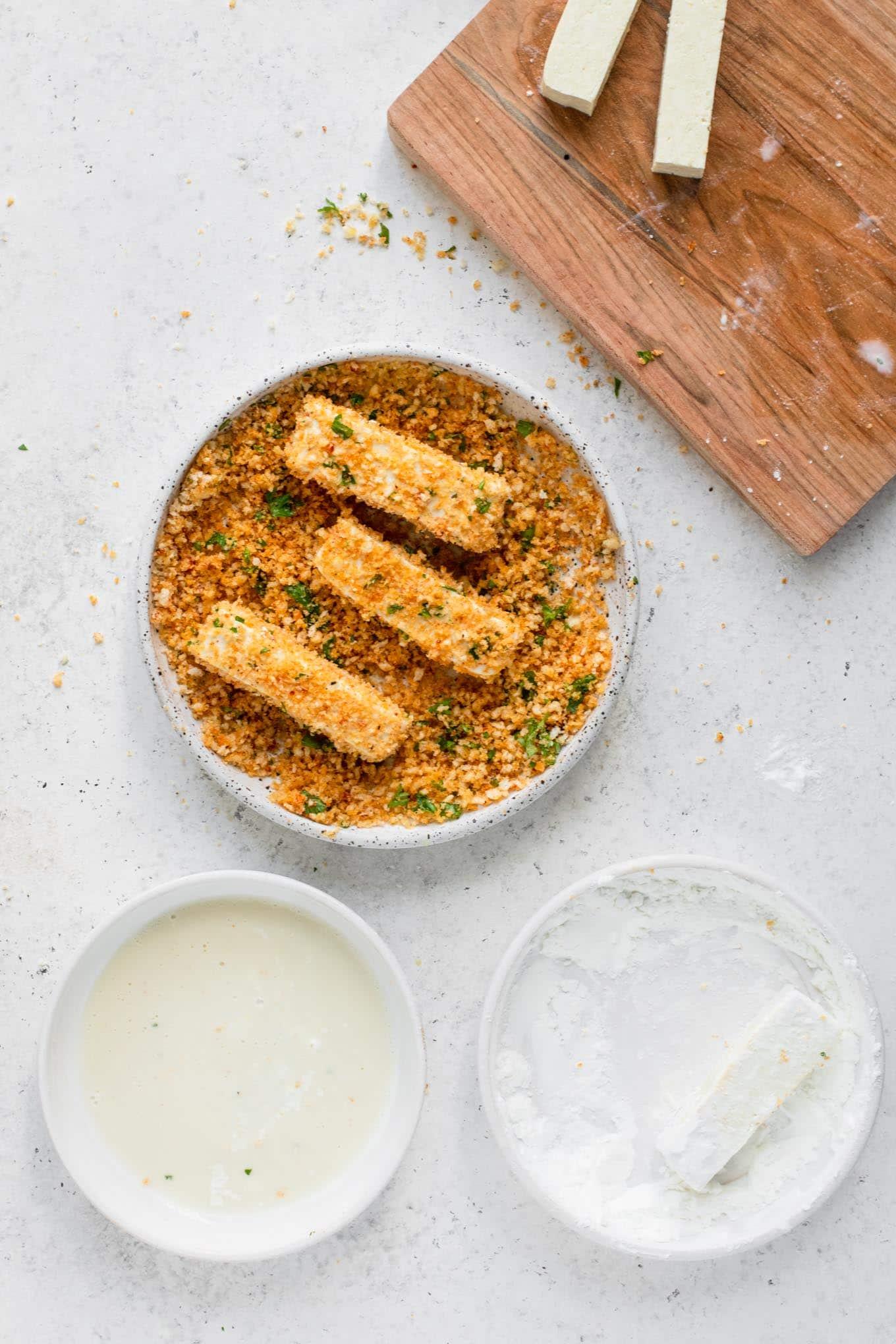 breading tofu in seasoned bread crumbs