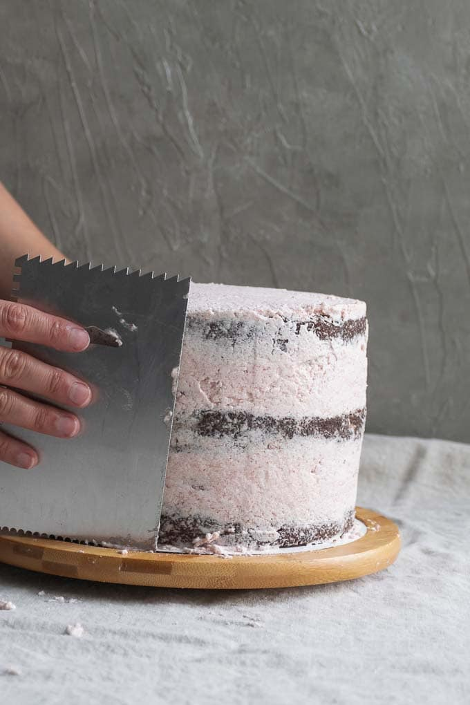 Vegan aquafaba strawberry Italian meringue buttercream - frosting the cake - 13