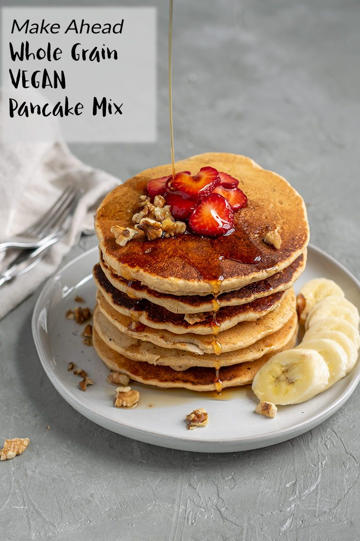 These fluffy whole grain pancakes are made with whole wheat pastry flour and cornmeal and stuffed with walnuts for a delicious and hearty vegan breakfast. Make the dry mix ahead of time for quick pancakes whenever you want! | thecuriouschickpea.com #veganbrunch #breakfast #vegan #pancakes #wholegrain