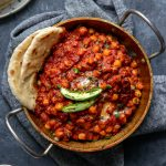 Restaurant style chana masala served with garlic naan and green chiles