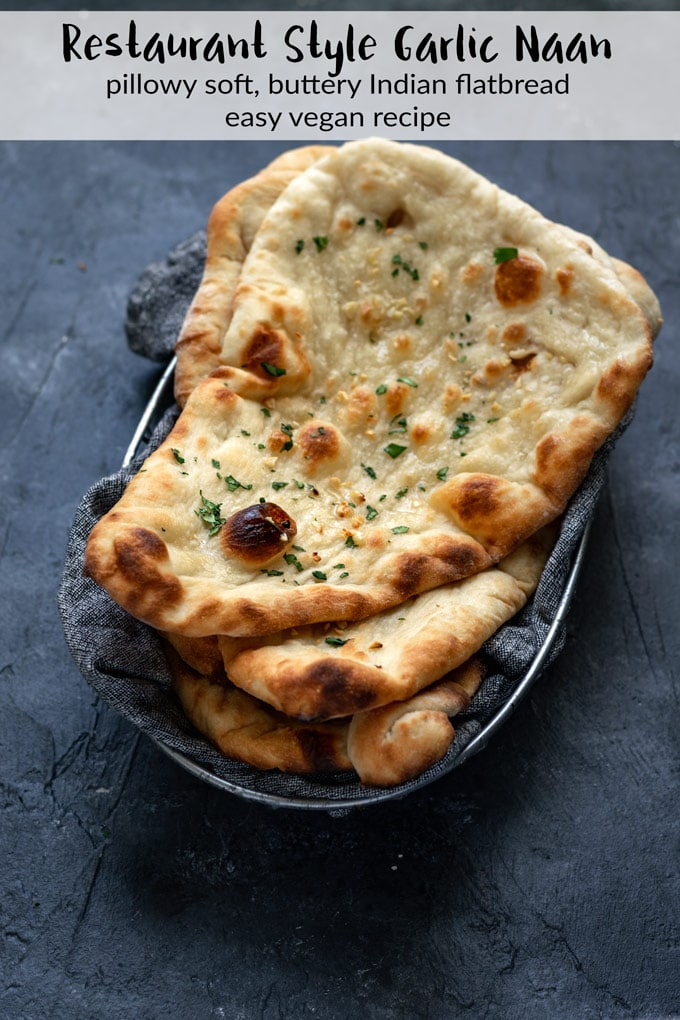 This vegan homemade restaurant style naan is easy to make. The flatbread comes out soft and bubbly and is perfect for scooping up delicious Indian curry!   thecuriouschickpea.com #vegan #indianfood #flatbread #garlicnaan