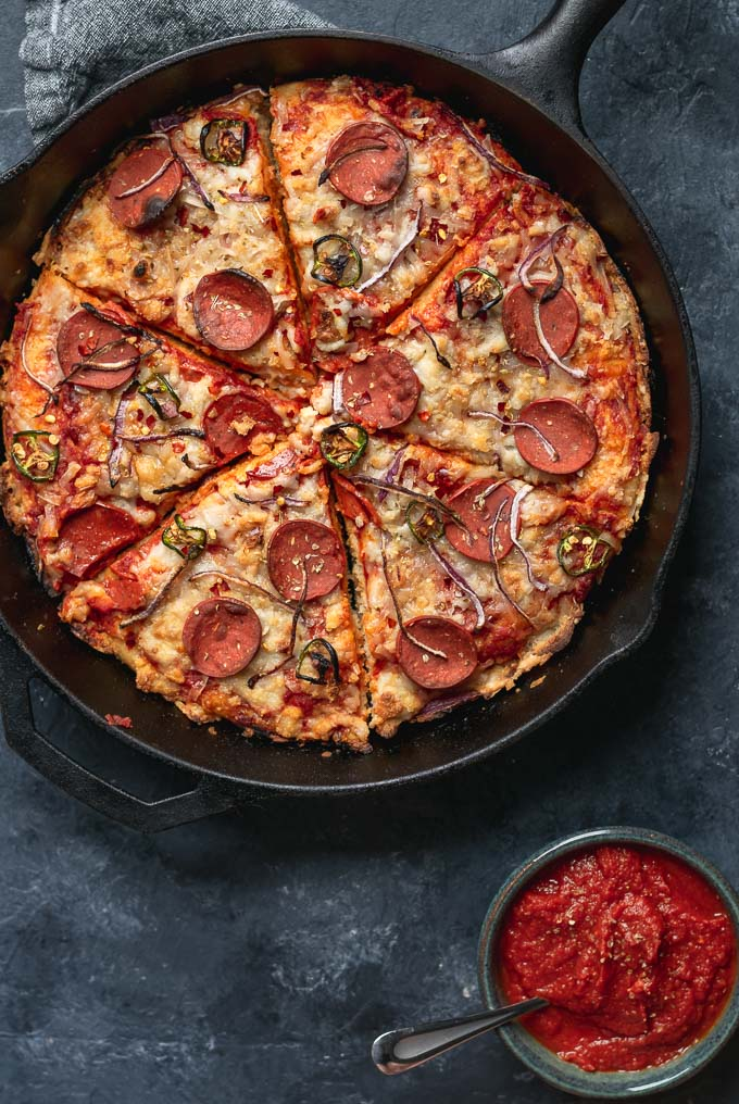 vegan pepperoni pan pizza in cast iron skillet