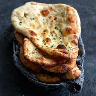 vegan homemade restaurant style naan, made into garlic naan