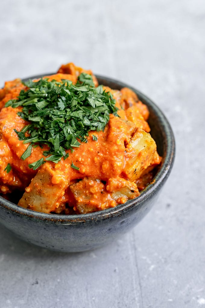 Easy romesco sauce on pan fried potatoes and garnished with parsley