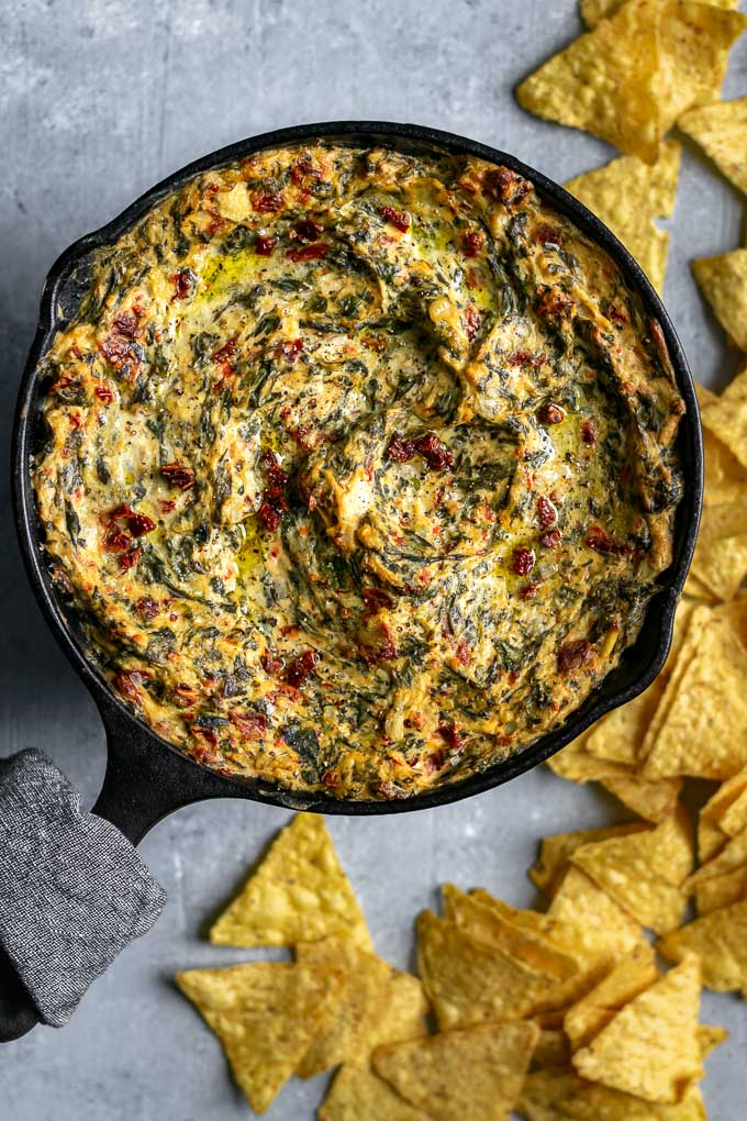 the best vegan spinach artichoke dip, baked in a small cast iron skillet