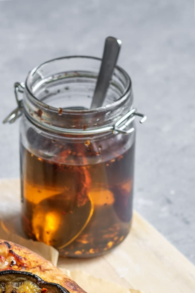 homemade chili oil in glass jar with a spoon