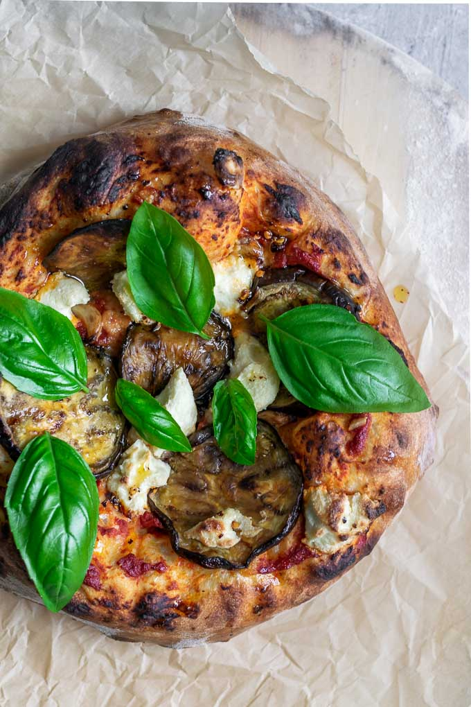 vegan roasted eggplant pizza with almond ricotta, roasted garlic, and chili oil