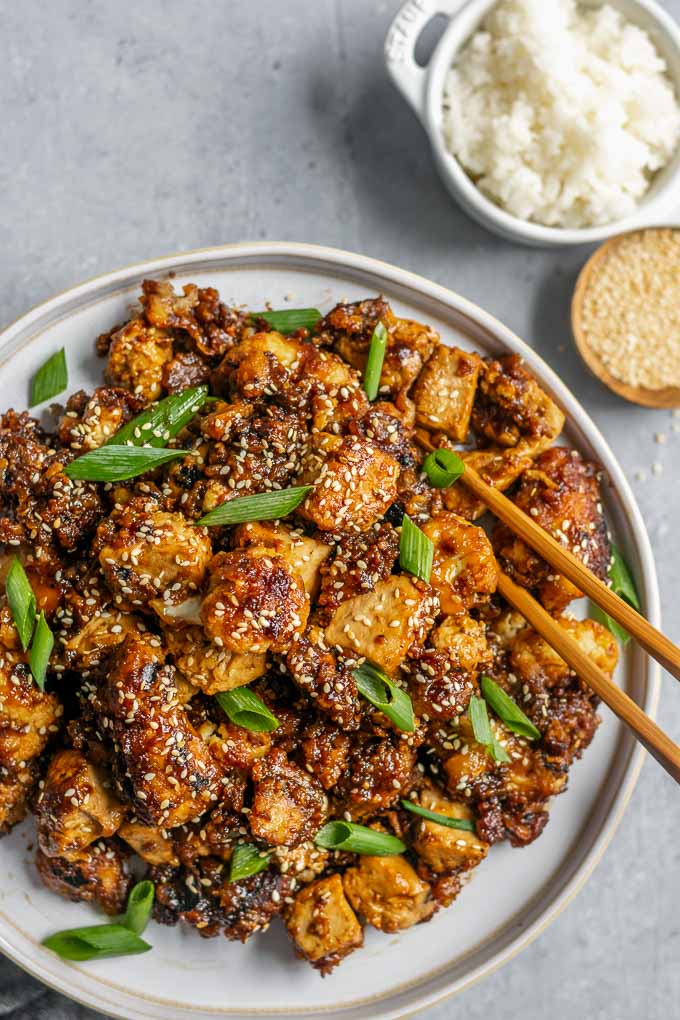 sticky teriyaki tofu and cauliflower with rice and toasted sesame seeds to serve