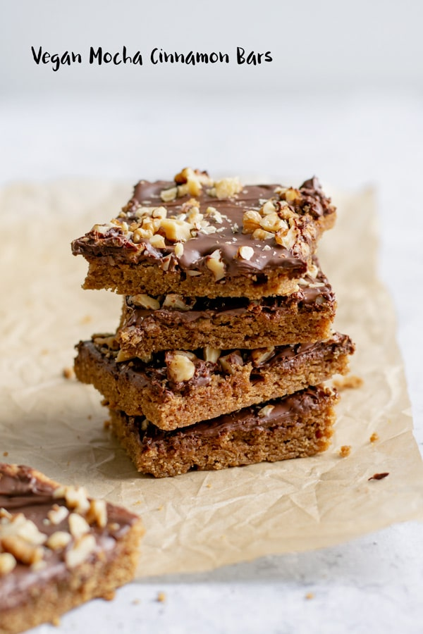 These vegan mocha cinnamon bars are an easy to bake delicious treat! Tender coffee-scented bars with a cinnamon kick, topped with chocolate and walnuts.   thecuriouschickpea.com #vegan #cookies #vegandesserts #veganbars #cookiebars #mocha #chocolate #cinnamon