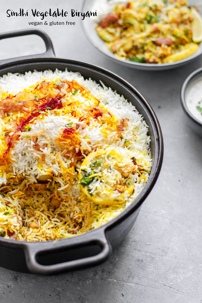 Sindhi Vegetable Biryani, layers of basmati rice and curried vegetables and chickpeas make up this delicious, popular recipe. It's vegan and gluten free! | thecuriouschickpea.com #vegan #vegetarian #veganindianfood #biryani #glutenfreevegan